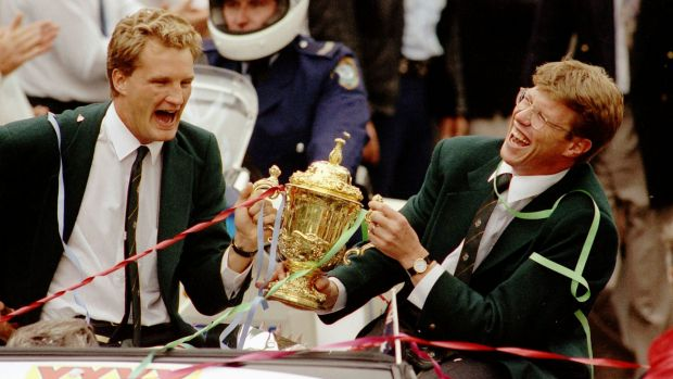 Michael Lynagh, left, holds the William Webb Ellis Trophy with Nick Farr-Jones.