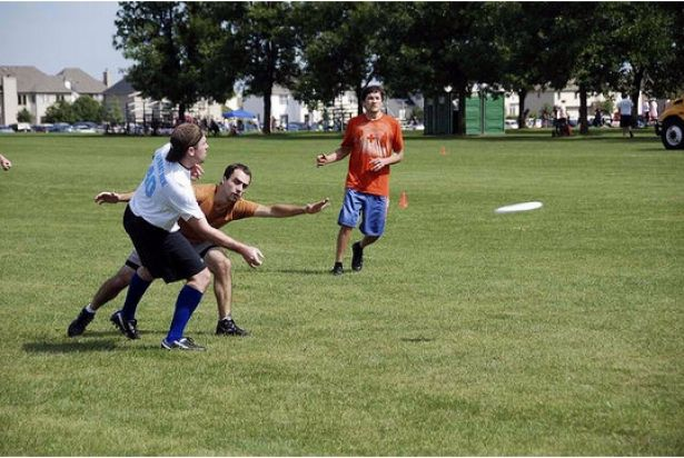 "Human: ""A group of men playing Frisbee in the park."" Computer model: ""A group of young people playing a game of Frisbee."""
