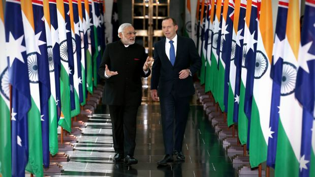 Indian Prime Minister Narendra Modi and Prime Minister Tony Abbott depart the House of Representatives after his address.