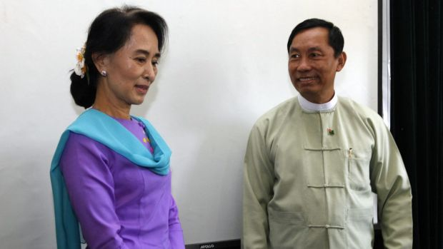 Myanmar's opposition leader Aung San Suu Kyi stands next to parliament speaker Shwe Mann in 2013.