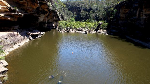 A woman died after falling off a cliff during a camping trip at Mermaid Pools near Tahmoor.