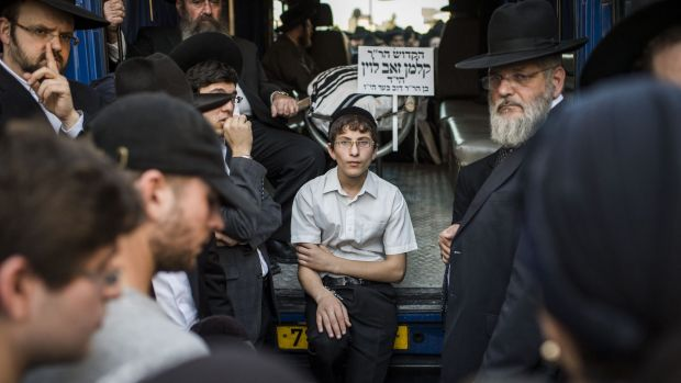 Mourners gather for the triple funeral of Rabbi Kalman Levine, Avraham Goldberg and Aryeh Kopinsky in Jerusalem.