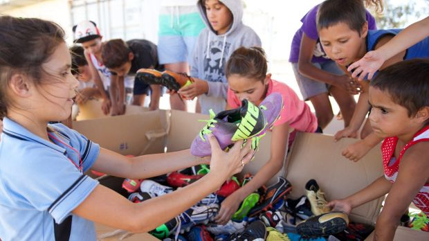 Sole food: Kids in Wilcannia this week enjoy their new boots.