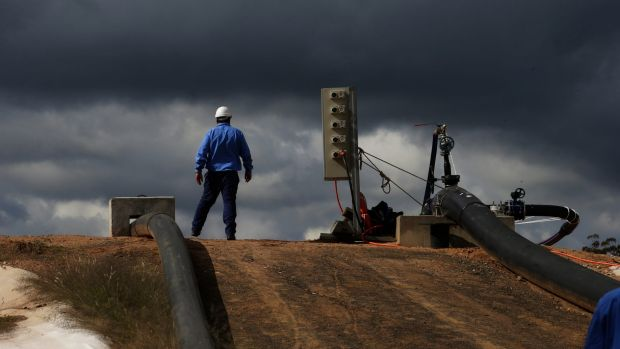 Fresh clouds over CSG industry: A Santos employee near Narrabri in northern NSW.