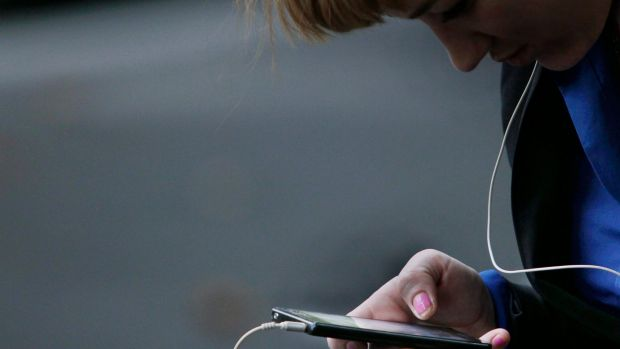 Position imperfect: A hunched position while texting could place pressure on your cervical spine.