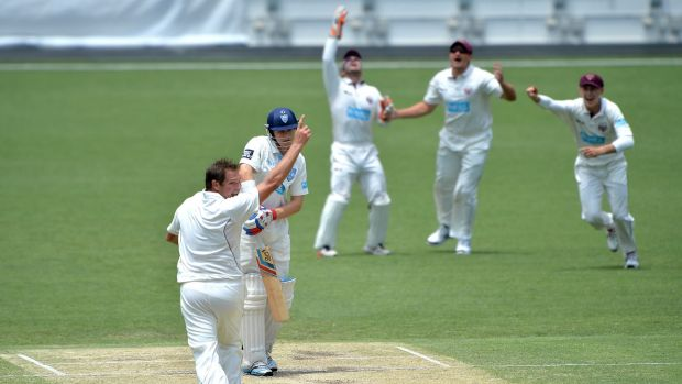 Howzat: Ryan Harris dismisses Scott Henry on his way to a four-wicket second-innings haul for Queensland against NSW.