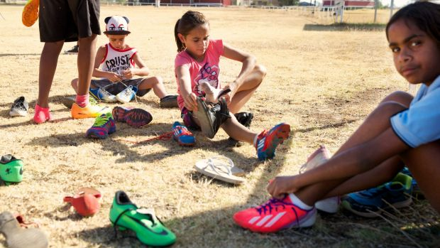 Much appreciated: Wilcannia kids busily trying on boots donated by <i>Herald</i> readers.