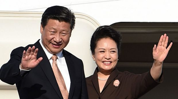 Clampdown: China's President Xi Jinping and his wife, Peng Liyuan, about to leave Sydney on November 19. Mr Xi has told ...