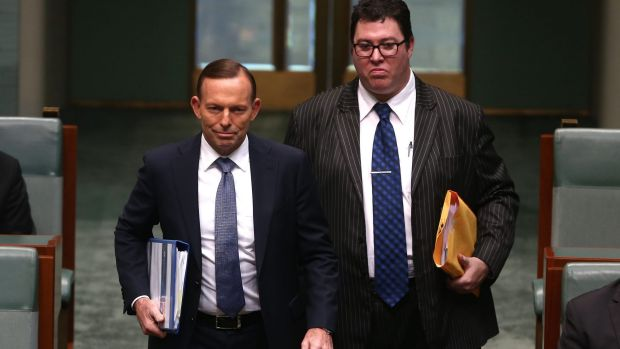 George Christensen and Tony Abbott enter Question Time together in October.