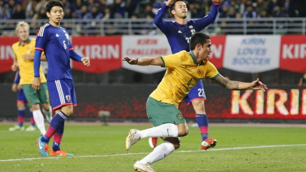 """We'll get there but we have to really concentrate on what's coming"": Tim Cahill celebrates after scoring against Japan."