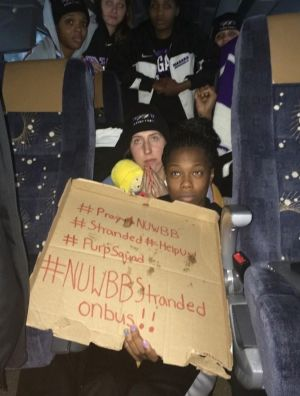 Team huddle: The Niagara University women's basketball team team hold a sign while their bus was stuck in snow in the ...
