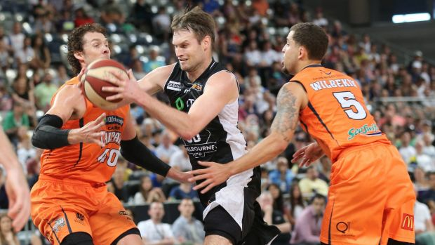 Crowded lane: Melbourne United veteran Mark Worthington tries to evade the Cairns defence.