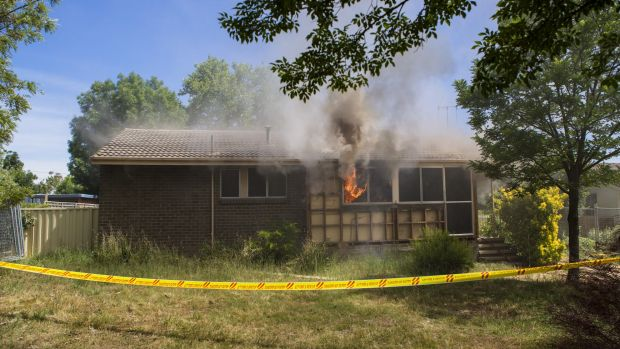 Hot property: Flames  billow from the windows of the Farrer house set alight for a training exercise.