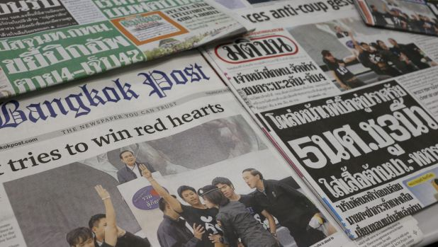Defiant symbol: Front pages of Thai newspapers show student protesters displaying the film's salute.