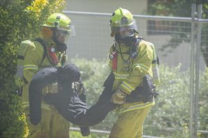 Saved: ACT Fire and Rescue crew carry a ''survivor'' to safety.