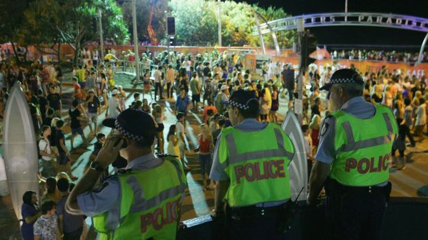 Police officers watch over the Schoolies week celebrations in Surfers Paradise.