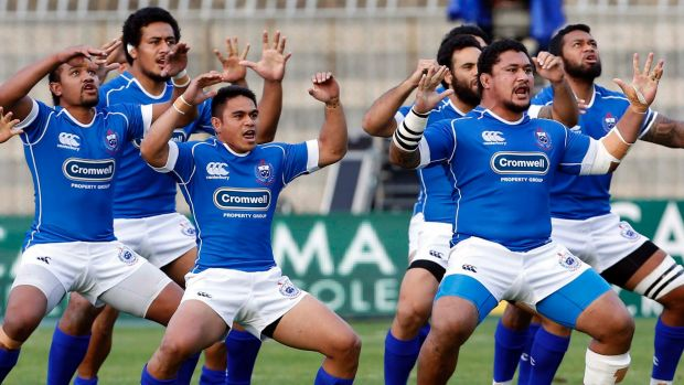 Challenge: Samoa perform the Siva Tua ahead of their rugby test against Italy.