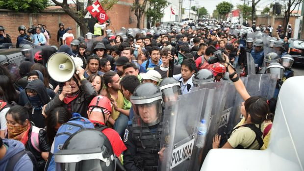 Outraged: People take part in a march protesting over the presumed massacre of 43 students in Mexico City.