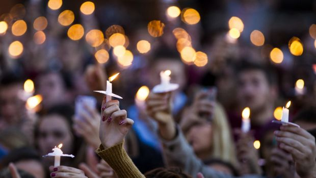 Vigil: Students hold candles aloft during at vigil on campus after the shooting of three FSU students.