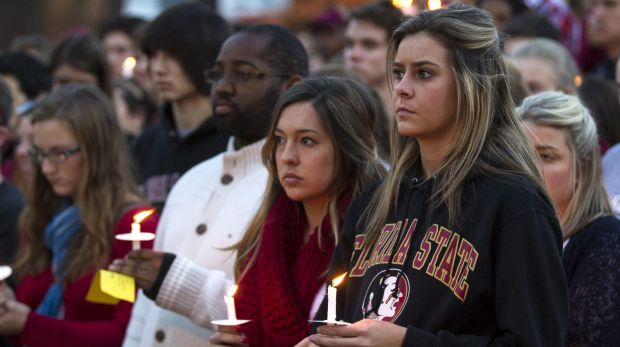 Sombre: Thousands of FSU students attended a vigil after the campus shooting.