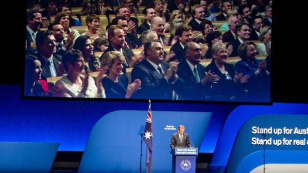 Tony Abbott's Coalition colleagues look on at yesterday's campaign launch.