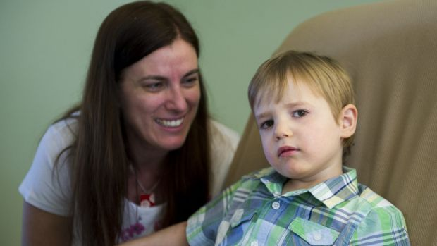 All smiles: Roslyn McKenzie and her five-year-old son Shaye who has an acquired brain injury.
