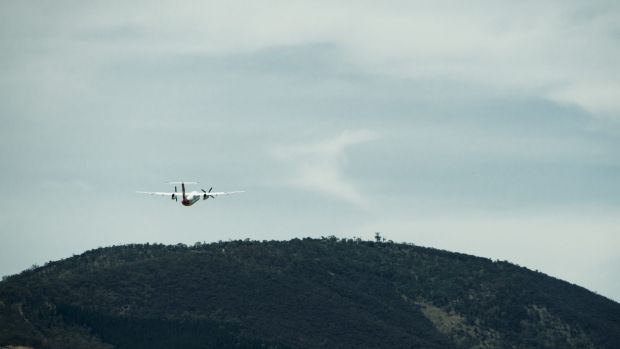 A plane departs Canberra, viewed from the airport tower.