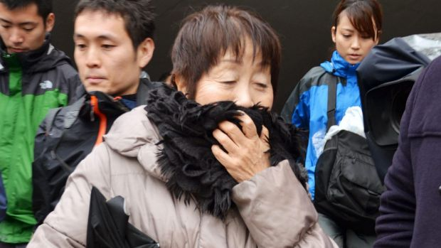 Chisako Kakehi speaks to the media following her arrest.