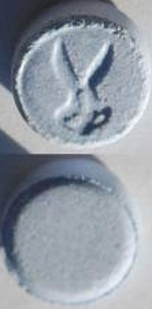 "An ""ecstasy"" pill, with scissor stamp, similar to the one used by the four people hospitalised ."