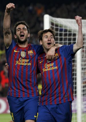 Brothers in arms: Cesc Fabregas and Lionel Messi during their time together at Barcelona.
