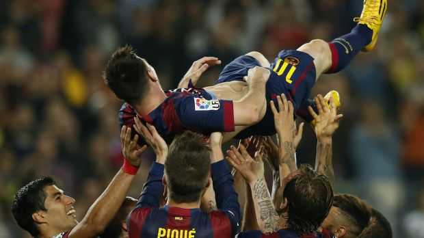 Lionel Messi's teammates hold him aloft after his hat-trick.