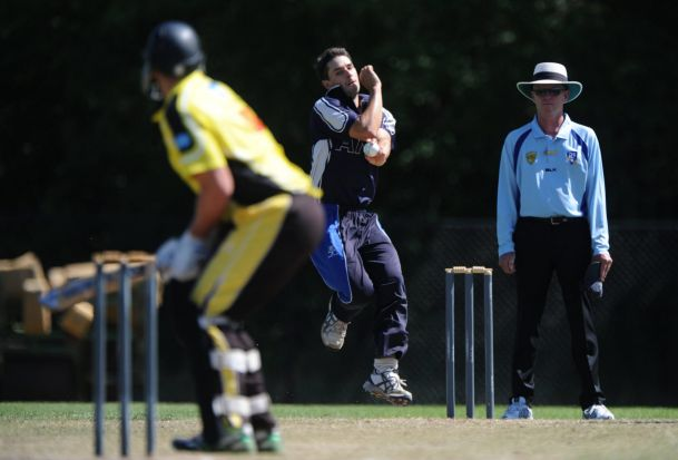 ANU bowler, Mark Bennett, in action.
