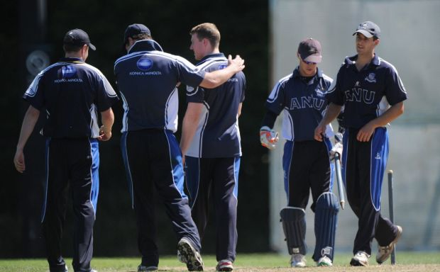 ANU bowler Scott Murn centre, is congratulated by team mates after bowling out Tom Elwood.