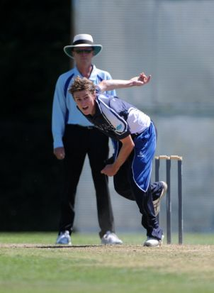 ANU bowler, Mark Bennett in action.