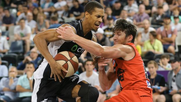 Stephen Dennis is fouled by Damian Martin.