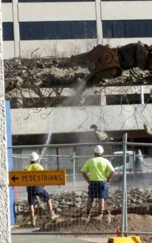 The demolition of a footbridge connecting Woden Plaza.
