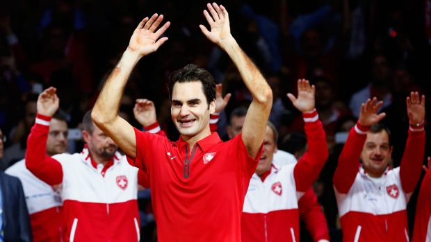 Roger Federer, of Switzerland, leads the celebrations after defeating Frenchman Richard Gasquet       in the Davis Cup ...