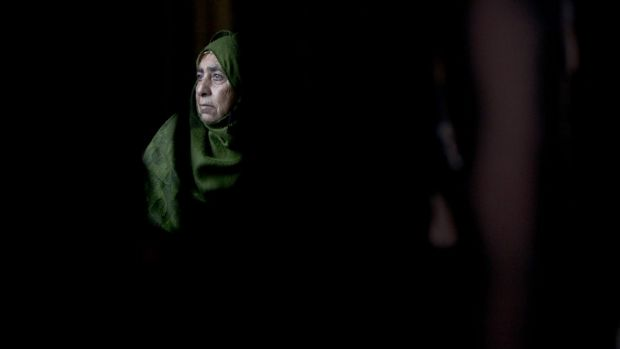 A Palestinian woman sits inside her home after an arson attack in Khirbet Abu Falah, north-east of Ramallah. The family ...