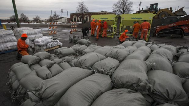 Braced: Emergency workers have filled thousands of sandbags in anticipation of water from melting snow.