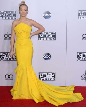 Rita Ora, in Zac Posen, had her hair done in the back of a taxi en route to the 2014 AMAs.