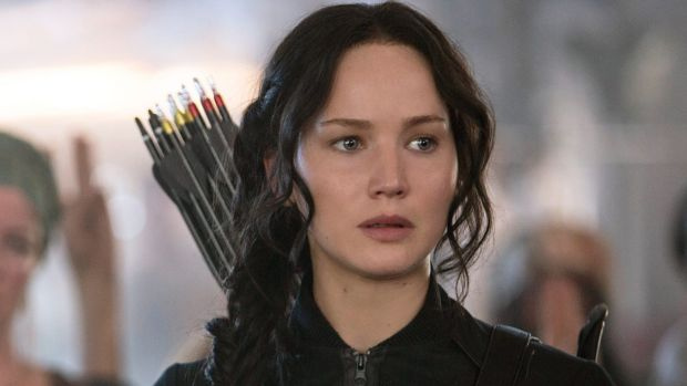 Ready for action: Jennifer Lawrence as Katniss Everdeen in a scene from <i>The Hunger Games: Mockingjay Part 1.</i>