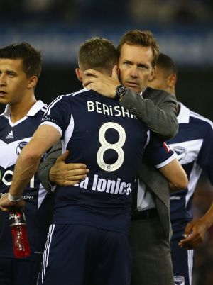 Different philosophies: Mike Mulvey hugs Besart Berisha of the Melbourne Victory after his final match in charge of the ...