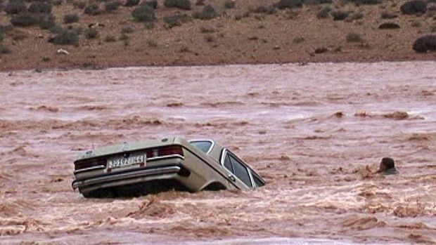 A driver and his car are washed away by flood waters in Ouarzazate, Morocco.