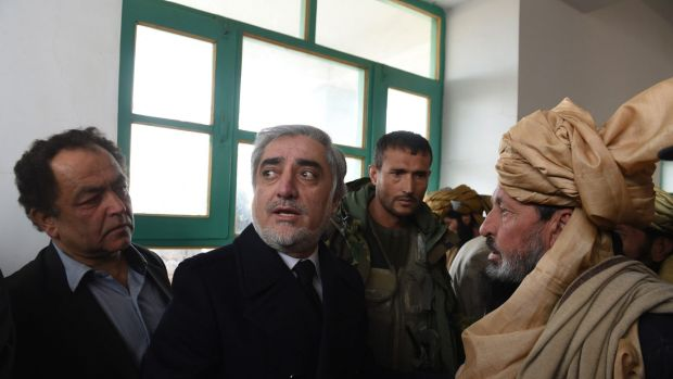 Afghanistan's Chief Executive Officer Abdullah Abdullah (second from left) speaks during his official visit to the Yahya ...