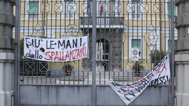 "A banner reads ""Hands off from the Spallanzani"" on the gate of the infectious diseases institute in Rome."