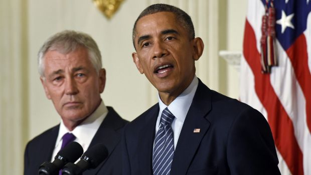 Warm words: Chuck Hagel listens as President Barack Obama talks about the Defence Secretary's resignation at the White House.