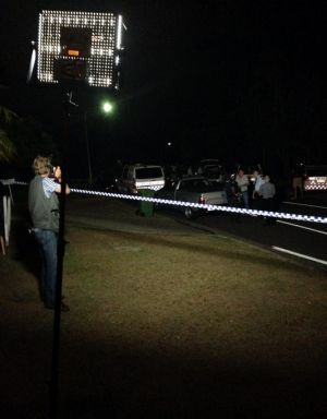 Police investigate after a man was shot on the Gold Coast on Monday night.