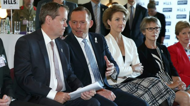 Opposition Leader Bill Shorten and Prime Minister Tony Abbott in discussion during the White Ribbon Day Breakfast at ...