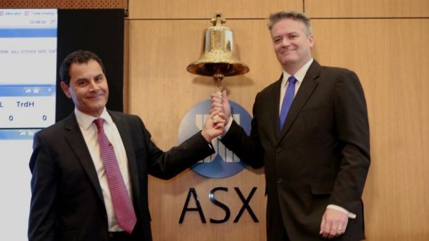 Medibank chief George Savvides and Finance Minister Mathias Cormann ring the bell to open Medibank Private for trading.