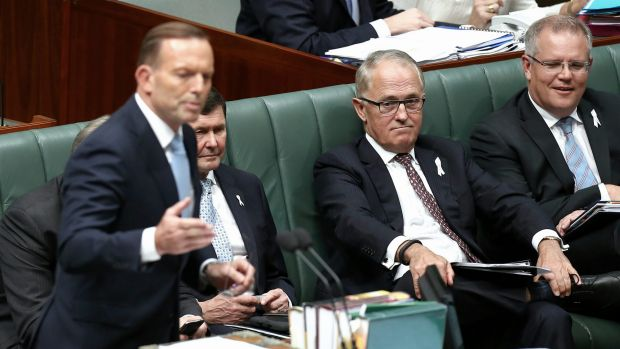 Communications Minister Malcolm Turnbull listens to the Prime Minister during Question Time on Tuesday.
